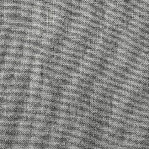 Ett kuddfodral i rufft linnetyg med handsydda stickningar Maroc